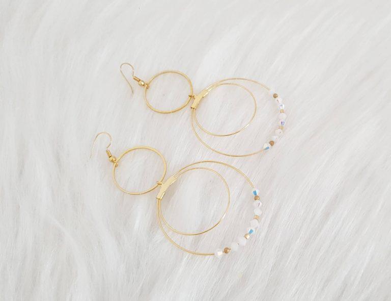 Boucles d'oreilles dorée blanche